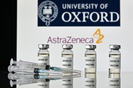 Phase 3 trials of the Oxford-AstraZeneca COVID-19 vaccine are now accumulating the data needed to report results as a renewed surge of the pandemic hits countries around the world, says Oxford scientist [File: Justin Tallis/AFP]