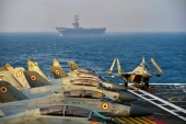 This handout photo shows Indian army fighter jets on the deck of an aircraft carrier during the second phase of the Malabar naval exercise in the Arabian sea [Indian Navy/ AFP]