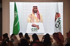 Saudi Arabian and foreign media representatives listen to Saudi Crown Prince Mohammed bin Salman remotely addressing a press conference at the G20 summit in Riyadh, on November 22, 2020 [Fayez Nureldine/AFP]
