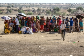 Ethiopian refugees who fled the fighting in the Tigray region gather upon arrival to a reception center in the Hamdayit area of Sudan's eastern Kassala state, on November 22, 2020. - Ethiopia's northern Tigray region has been rocked by bloody fighting since November 4, when Ethiopia announced the launch of military operations there. The ongoing conflict is reported to have killed hundreds of people and forced thousands more to flee into neighbouring Sudan. (Photo by ASHRAF SHAZLY / AFP) (AFP)