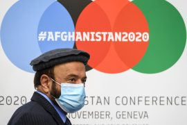 Afghanistan's Economy Minister Abdul Hadi Arghandiwal attends a press conference closing the 2020 Afghanistan donor conference hosted by the United Nations [Fabrice COFFRINI/AFP]