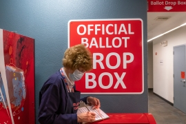 An election worker makes a record of a ballot pickup on November 3, 2020 in Vancouver, Washington. After a record-breaking early voting turnout, Americans head to the polls on the last day to choose between incumbent President Donald Trump and Democratic nominee Joe Biden in the 2020 presidential election [Nathan Howard/Getty Images/AFP] (AFP)