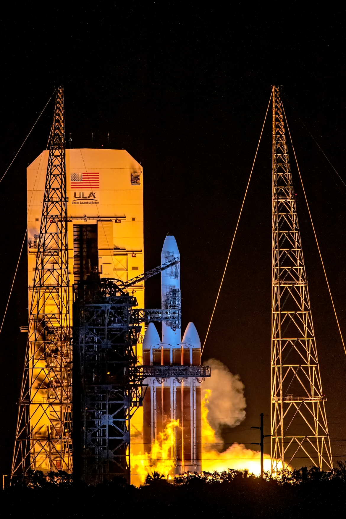 United Launch Alliance Delta IV Heavy carrying a classified satellite for the National Reconnaissance Office. This was a hot launch abort with three seconds to go before liftoff. [Michael Tracy/Al Jazeera]