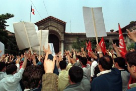 In this file image from 1998, protesters make the grey wolf sign outside the French consulate in Istanbul as they protest against France over the National Assembly's vote recognising the killing of Armenians during the first world war as genocide [Reuters]
