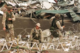 US Marines stand guard outside the US Embassy in Nairobi in 1998 after it was destroyed by a bomb [File: Reuters]