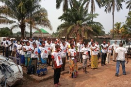 Red Cross volunteers in Equateur province are briefed before heading out into their communities to share life-saving information on the prevention of both Ebola and COVID-19 [Red Cross]