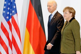 German Chancellor Angela Merkel and then-US Vice President Joe Biden arrive to make a statement to the media before talks in Berlin February 1, 2013 [Tobias Schwarz/Reuters]