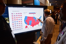 A delegate looks at an electoral map at the Democratic National Convention in Philadelphia, Pennsylvania. US on July 27, 2016. [File: Reuters/Charles Mostoller]