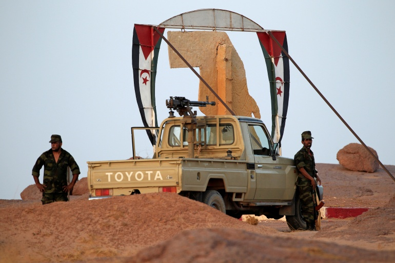 Polisario Front soldiers stand at an entrance of the fifth sector base in Bir Lehlou, Western Sahara [File: Zohra Bensemra/Reuters]
