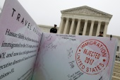 A mock-up of banned Muslim travellers' passport is placed outside the US Supreme Court, while it weighs the legality of President Donald Trump's travel ban targeting people from Muslim-majority countries in Washington, DC, US [File: Yuri Gripas/Reuters]
