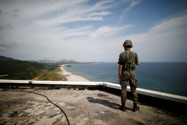 A South Korean soldier stands guard just south of the demilitarised zone separating the two Koreas in Goseong, South Korea [File: Kim Hong-Ji/Reuters]