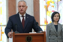 Igor Dodon, left, will face ex-Prime Minister Maia Sandu in the second round of the election [File: Valentyn Ogirenko/Reuters]