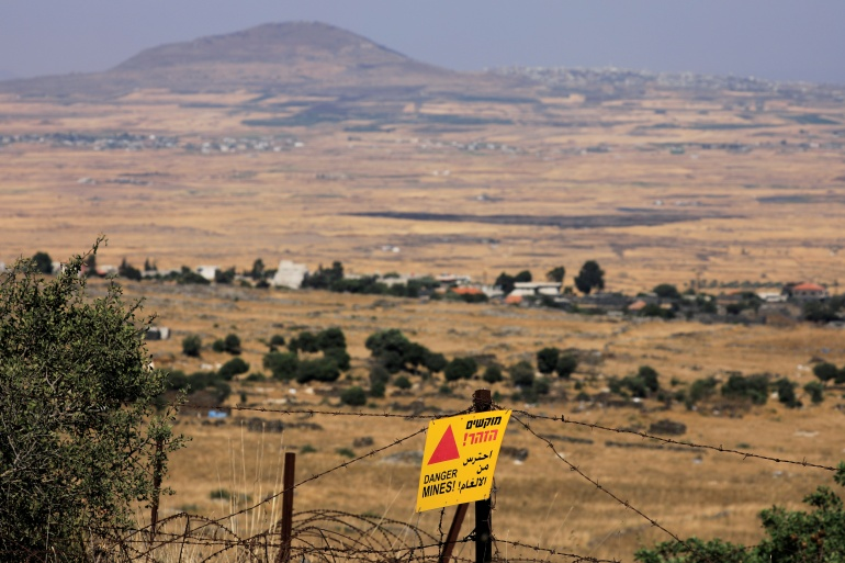 A 'Danger, Mines' sign is seen at the Israeli-controlled Golan Heights near the Israel-Syria frontier on August 4, 2020 [File: Amir Cohen/ Reuters]