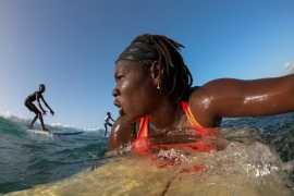 Khadjou Sambe, 25, Senegal's first female professional surfer, paddles during a training session off the coast of Ngor, Dakar, Senegal, on August 18, 2020. 'When I am in the water I feel something extraordinary, something special in my heart,' said Sambe [Zohra Bensemra / Reuters]