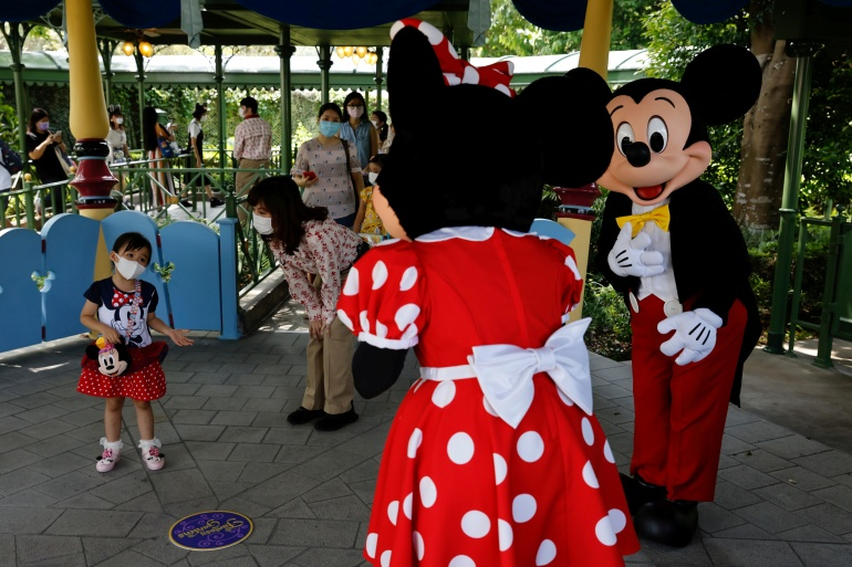 Disney's theme parks outside the US, including Hong Kong, have reopened with strict measures to prevent the spread of the coronavirus [File: Tyrone Siu/Reuters]