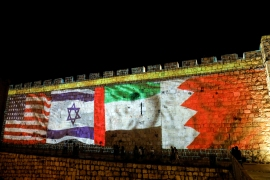 National flags of Bahrain, UAE, Israel and the US are projected on the walls of Jerusalem's Old City [File: L Ronen Zvulun/Reuters]