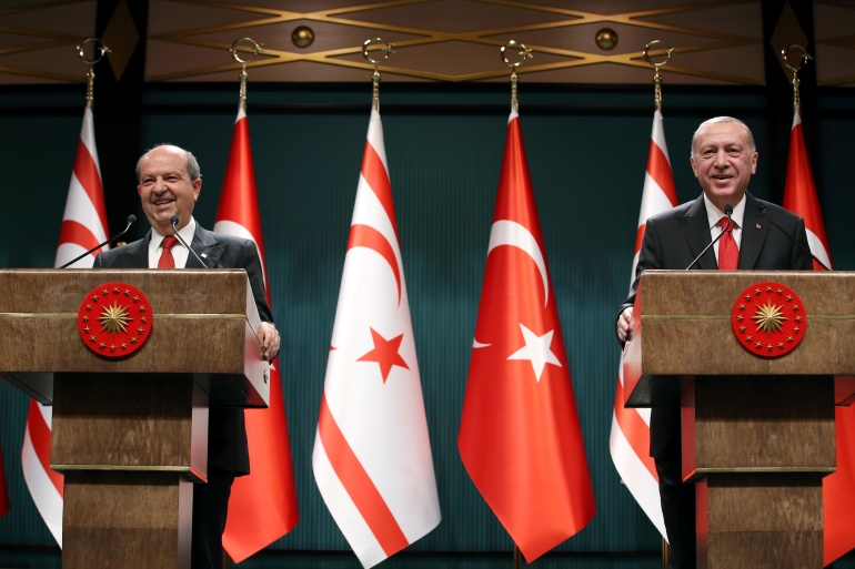 Turkish President Tayyip Erdogan and Turkish Cypriot leader Ersin Tatar attend a news conference at the Presidential Palace in Ankara, Turkey, on October 26, 2020 [Presidential Press Office/Handout via Reuters]