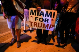 A supporter of President Donald Trump holds a sign during the 2020 US presidential election, at Little Havana neighbourhood in Miami, Florida, US [Marco Bello/Reuters]