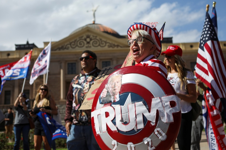 United States President Donald Trump says the 'election is far from over', a statement that his supporters have echoed at rallies across the country [Jim Urquhart/Reuters]