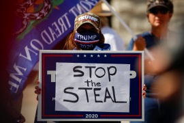 "A supporter of US President Donald Trump holds a sign during a ""Stop the Steal"" protest after the 2020 US presidential election was called by the media for Democratic candidate Joe Biden, in front of the Arizona State Capitol in Phoenix, Arizona, US, November 7, 2020. [Jim Urquhart/Reuters]"