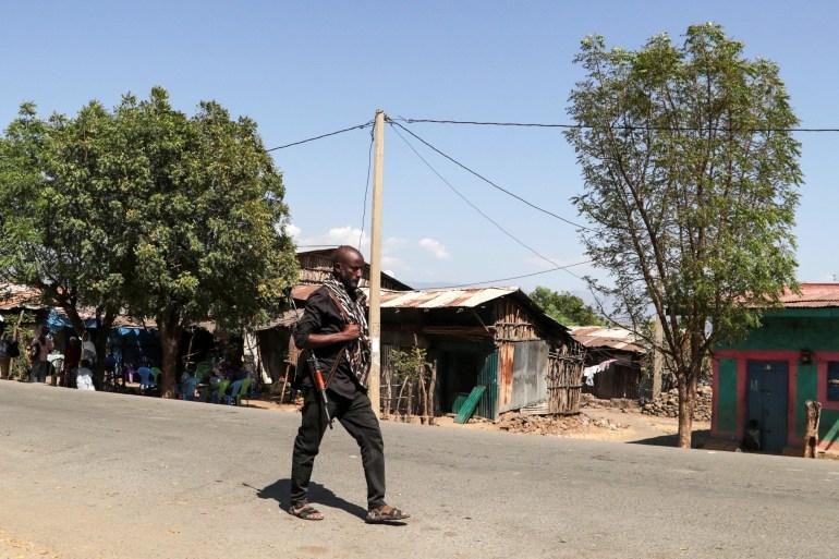 A member of the Amhara Special Force patrols a street in Soroka village in Amhara region near the border with Tigray [File: Tiksa Negeri/Reuters]