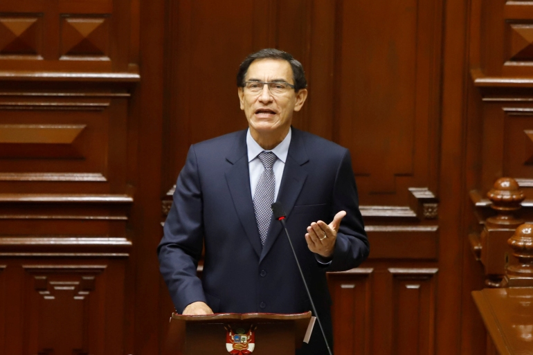 President Martin Vizcarra defends himself in an impeachment trial brought by Peru's Congress over alleged corruption. Some 105 members of Congress backed his removal from office [Peruvian Presidency/Reuters]