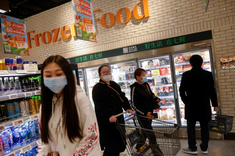 Peple shop in the frozen food section at JD's 7Fresh supermarket on China's Singles Day shopping festival in Beijing, China November 11, 2020 [Thomas Peter/Reuters]