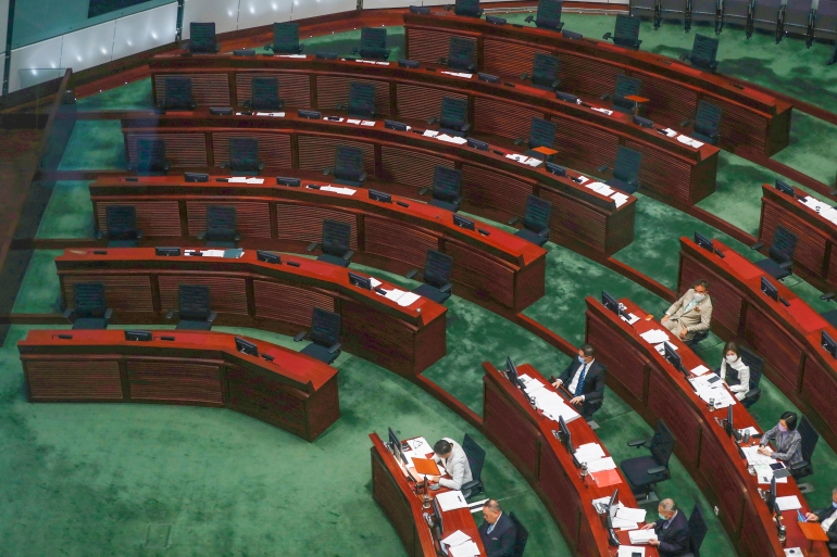 Empty seats, where the pro-democrats would normally sit, inside the chamber of Hong Kong's Legislative Council [Tyrone Siu/Reuters]