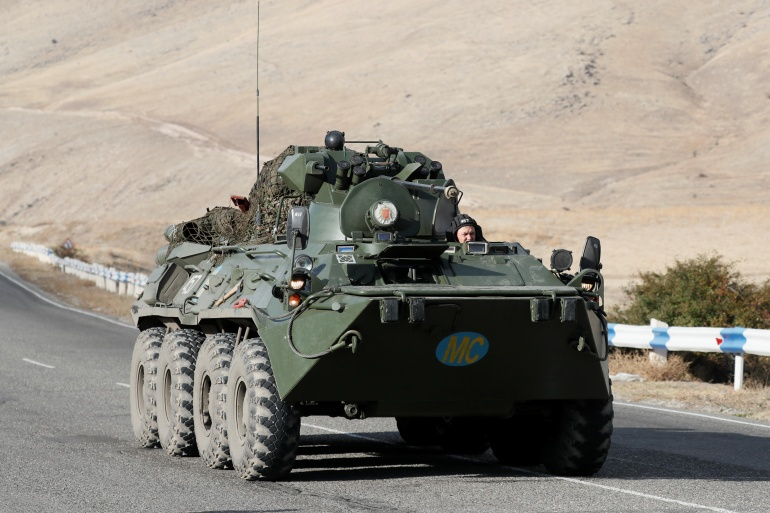 An armoured personnel carrier of the Russian peacekeeping troops drives along a road outside the village of Yelpin, Armenia, on Thursday [Gleb Garanich/Reuters]