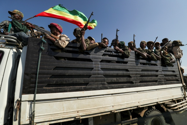 Members of the Amhara region armed group head off to fight the Tigray People's Liberation Front [File: Tiksa Negeri/Reuters]