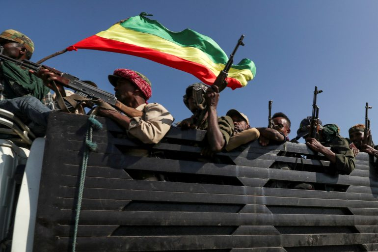 Members of Amhara region fighters head off to face the Tigray People's Liberation Front [File: Tiksa Negeri/Reuters]