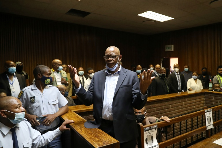 Ace Magashule, the secretary general of South Africa's ruling African National Congress, gestures as he appears at the Bloemfontein court [Siphiwe Sibeko/Reuters]