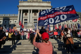 Supporters of US President Donald Trump rally outside the State Capitol building after news media declared Biden to be the winner of the 2020 US presidential election, in Harrisburg, Pennsylvania, US [Leah Millis/Reuters]