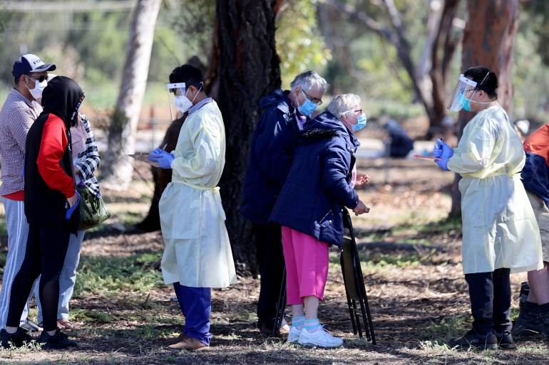 Thousands of people in South Australia have been queueing to get tested for COVID-19 after a spike in cases that has prompted the state government to impose a strict six-day lockdown [Kelly Barnes/AAP via Reuters]