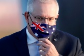 Australian Prime Minister Scott Morrison is demanding the removal of a 'repugnant' post by a senior Chinese official and an apology [File: Issei Kato/Reuters]
