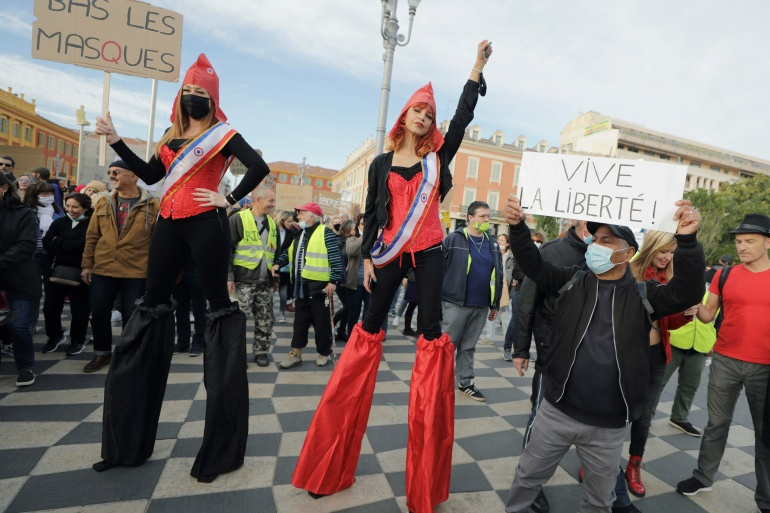 Women dressed as Marianne, the symbol of French Republic, attend a demonstration to protest against a bill that would make it a crime to circulate an image of a police officer's face, in Nice, France, November 21, 2020 [Eric Gaillard/Reuters]