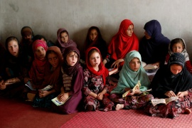 Internally displaced Afghan girls at a mosque in Kabul amid the spread of COVID-19 disease during the holy month of Ramadan [File: Mohammad Ismail/Reuters]