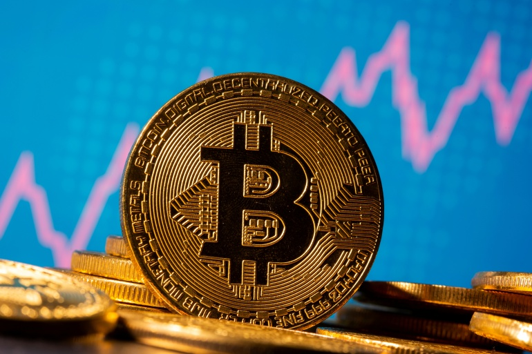 Last month Canadian securities regulators cleared the launch of the Purpose Bitcoin ETF, making it the first to gain regulatory approval in North America [File: Dado Ruvic/Illustration/Reuters]