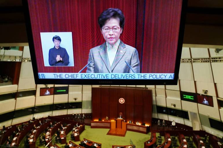 After a month-long delay, Lam delivered her annual policy address at the Legislative Council in Hong Kong on Wednesday [Lam Yik/Reuters]
