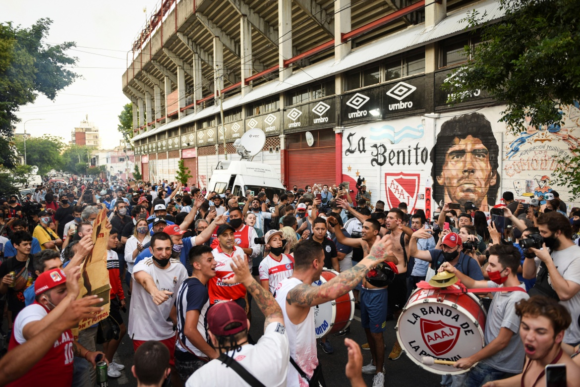 People gather to mourn the death of the football legend outside the Diego Armando Maradona stadium. [Martin Villar/Reuters]