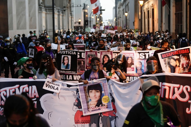 Demonstrators march during a protest to mark the International Day for the Elimination of Violence against Women, in Lima, Peru November 25, 2020 [Angela Ponce/Reuters]