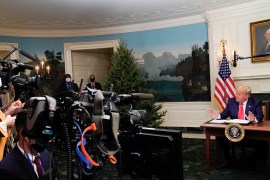 US President Donald Trump speaks to reporters after participating in a Thanksgiving video teleconference with members of the military forces at the White House in Washington, on November 26, 2020 [Reuters/Erin Scott]