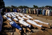 A mass burial took place on Sunday at Zabarmari village [Ahmed Kingimi/Reuters]