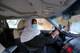 Naela Abu Jibba is the first female taxi driver in Gaza but has faced criticism while breaking stereotypes [Ashraf Amra/Al Jazeera]