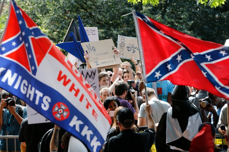 A group of protesters demonstrate against a KKK rally in Charlottesville in 2017 [File: Steve Helber/AP Photo]