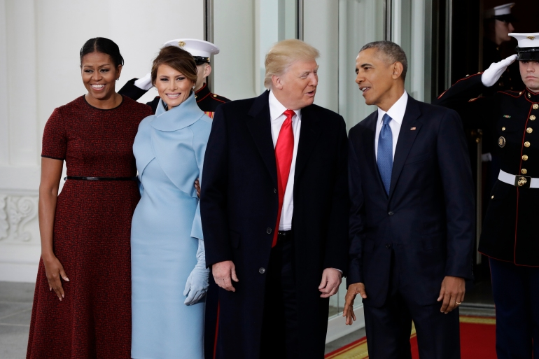 In this file photo from January 2017, President Barack Obama and First Lady Michelle Obama pose with President-elect Donald Trump and his wife Melania at the White House [File: Evan Vucci/AP Photo]