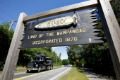 A wooden sign advises motorists of the location of Mashpee Wampanoag tribal lands in Massachusetts in the US [Steven Senne/AP Photo]
