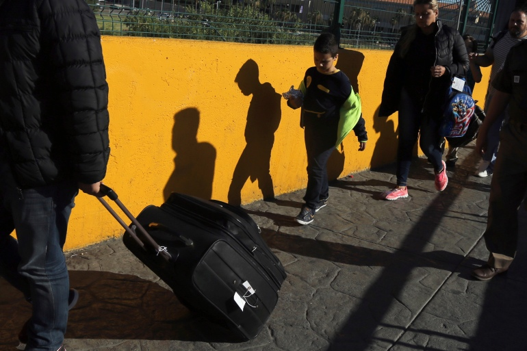 Border agents have forced many people to return to Mexico right away, while detaining others in holding facilities or hotels, sometimes for days or weeks [Marco Ugarte/AP Photo]