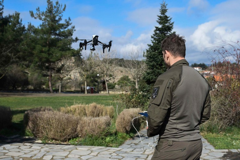 An Austrian police special forces pilot tests a drone in Dadia village, near the Greek-Turkish border on March 11, 2020 [File: AP/Giannis Papanikos]