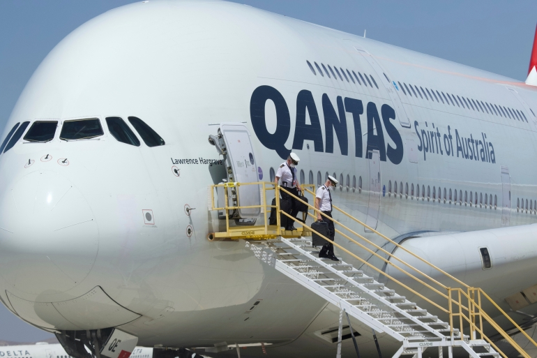 The chief of Qantas said his carrier will likely require passengers to have a COVID-19 vaccine once the jabs are widely available [File: Matt Hartman/AP]